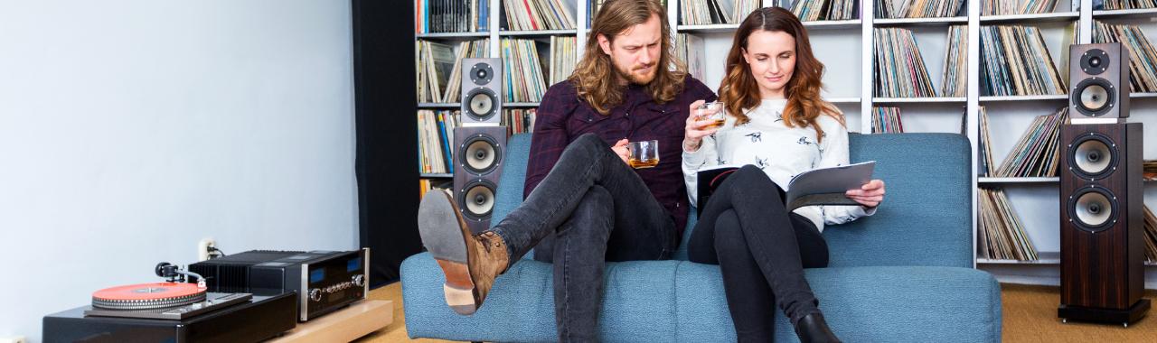 Listening to vinyl records.